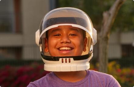 child wearing an astronaut helmit