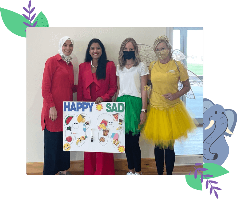 Dr. Jindal and staff with happy sad sign