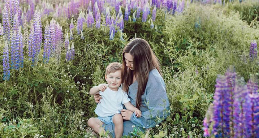 Woman with child in lavender field
