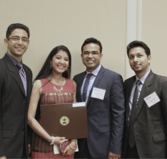 Dr. Jindal receiving an award with three other people